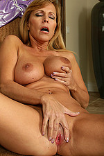 AllOver30 Matures MILFs XXX Photos Naked 2011-09-19 Mature Nicole fondle her massive tits while masturbating on a chair